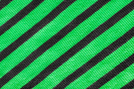 knitwear: Striped green and black knitwear texture as a background Stock Photo