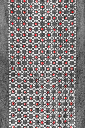 knitwear: White and red crystals on gray knitwear as a background