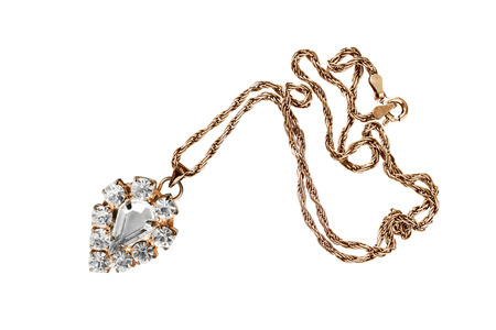 diamond necklace: Vintage crystal pendant on golden chain isolated over white