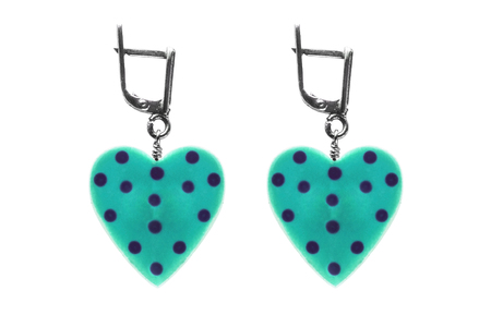 plastic heart: Blue plastic heart earrings on white background