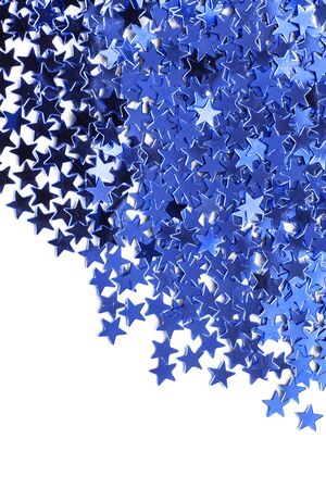 star shaped: Blue shiny star shaped confetti on white as a background