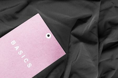 basics: Pink label lettered basics on black draped silk