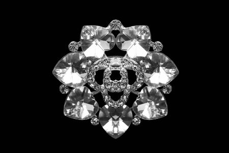 brooch: Diamond and crystal brooch isolated over black