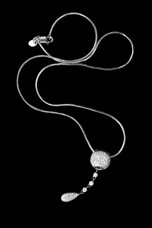 Diamond silver elegant necklace on black background