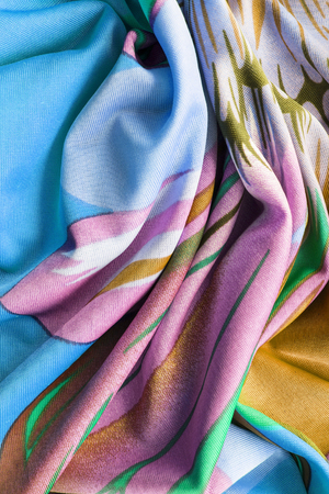 draped cloth: Draped silk pastel cloth as a background