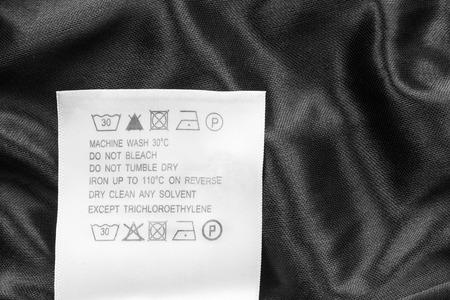 black satin: Washing instructions clothes label on black satin