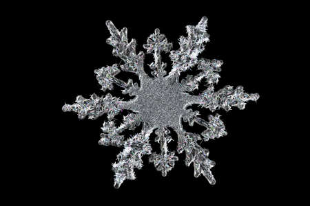 christmas element: Decorative glass snowflake isolated over black
