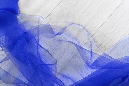 draped cloth: Folded blue chiffon on gray wooden floor as a  background