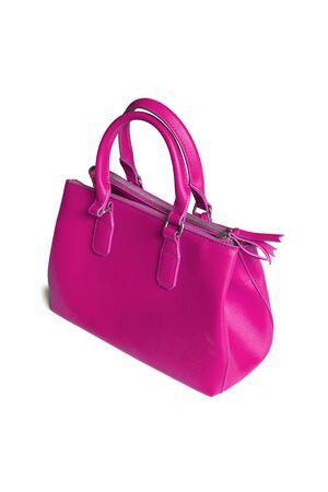 magenta: Magenta pink leather handbag isolated over white
