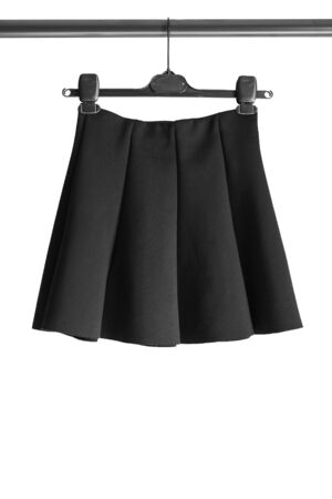 basics: Black basics skirt on clothes rack isolated over white