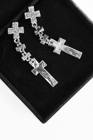 black velvet: Silver cross earrings with crystals in black velvet box closeup