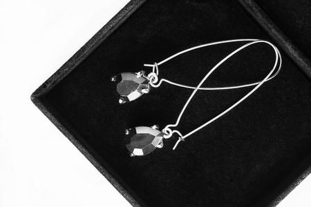onyx: Black onyx earrings in velvet jewel box as a background