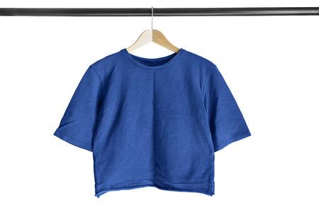 sudadera: Blue cotton sweatshirt on clothes rack isolated over white