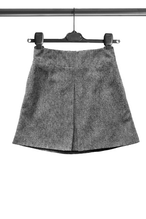 tweed: Gray tweed basic skirt on clothes rack isolated over white Stock Photo
