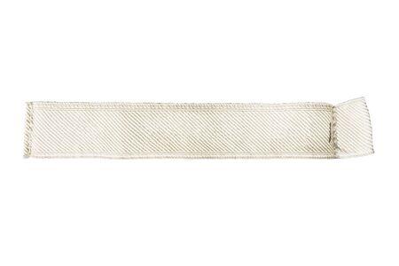 白で分離されたベージュの空白服ラベル 写真素材