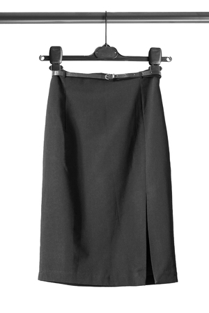 slit: Black pencil slit skirt on clothes rack isolated over white