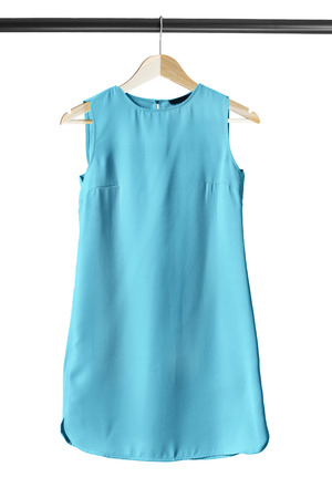 basics: Blue basics mini dress on clothes rack isolated over white Stock Photo