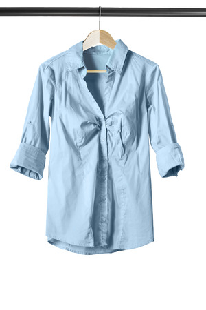 formal dressing: Blue cotton blouse on clothes rack isolated over white