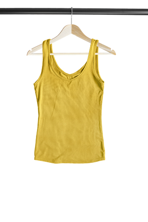 basics: Yellow basics tank top on clothes rack isolated over white Stock Photo