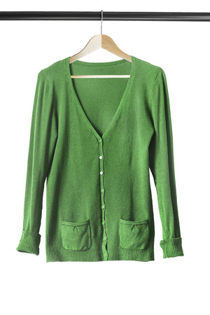 cardigan: Green cashmere cardigan on clothes rack isolated over white Stock Photo