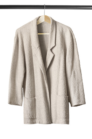 topcoat: Beige wool topcoat on wooden clothes rack on white background