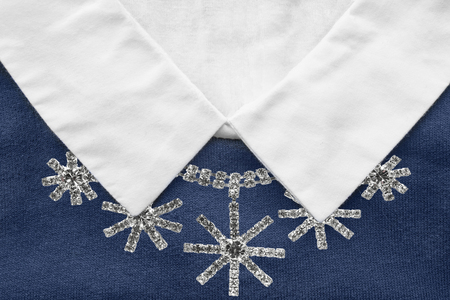 diamond necklace: Diamond necklace on blue pullover with white collar closeup