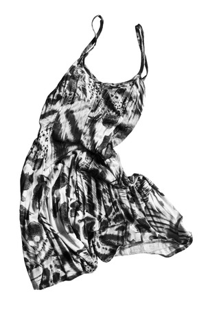 sundress: Crumpled black and white silk sundress on white background