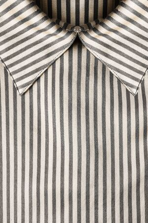 neckband: Striped satin blouse collar closeup as a background