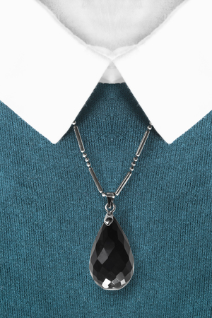 formal dressing: Black onyx pendant on blue pullover with white collar closeup