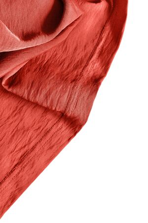 draped cloth: Terracotta draped silk on white background