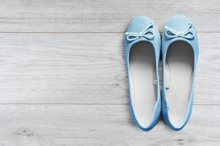 flat shoes: Pair of beautiful blue flat shoes on wooden floor