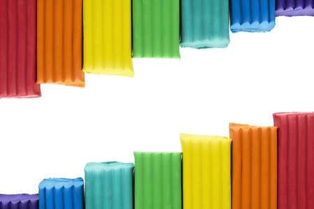 modeling clay: Colorful modeling clay blocks isolated over white