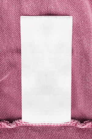 docket: Blank white clothes label on pink cloth as a background