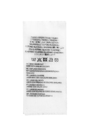 docket: Fabric composition and washing instructions label on white background Stock Photo