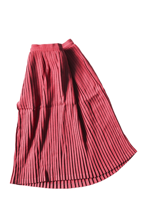 pleated: Red pleated skirt folded on white background Stock Photo