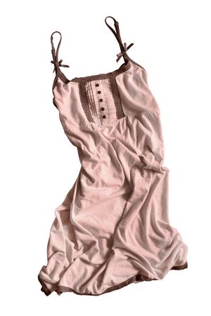 cotton dress: Crumpled beige cotton dress on white background