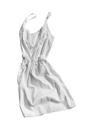 sundress: White linen sundress folded on white background Stock Photo