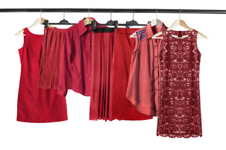 Group of red clothes on clothes rack isolated over white Stock Photo