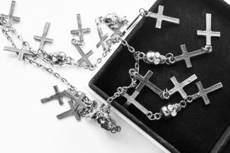 jewel box: Silver chain with crosses and skulls in black jewel box