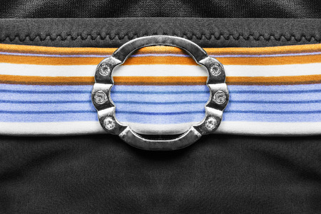 buckle: Silver buckle with crystals on striped belt closeup Stock Photo