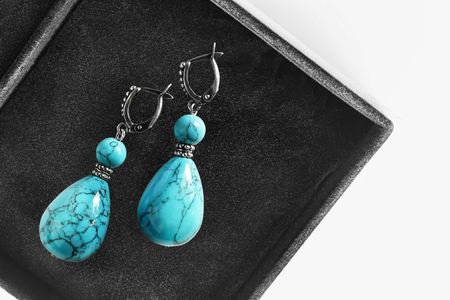 jewel box: Vintage turquoise earrings in black jewel box as a background Stock Photo