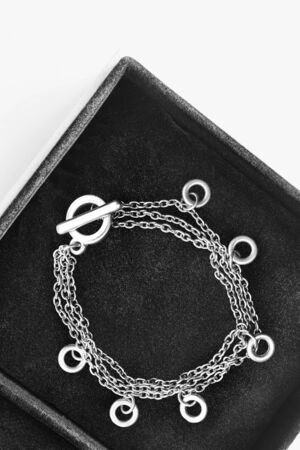 jewel box: Silver chain bracelet in black jewel box as a background Stock Photo