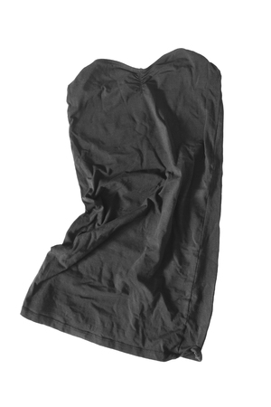 strapless dress: Black mini strapless dress crumpled on white background