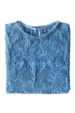 blouse: Folded blue lacy blouse on white background