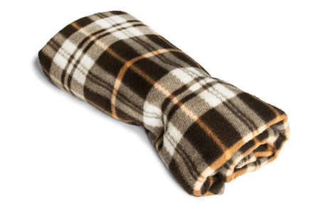 fleece: Brown fleece plaid folded on white background Stock Photo