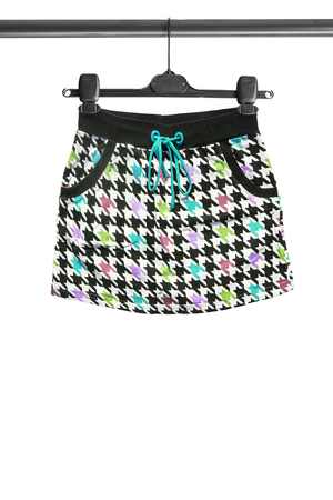 mini skirt: Colorful mini skirt on clothes rack isolated over white