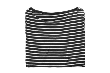blak and white: Folded blak and white striped shirt isolated over white Stock Photo