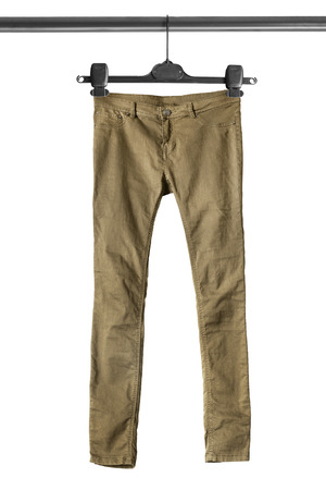 khaki pants: Khaki pants on clothes rack isolated over white