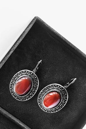 jasper: Ethnic jasper earrings in black jewel box closeup