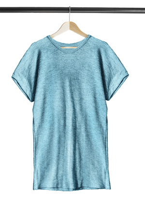 Blue basic tunic on wooden clothes rack isolated over white
